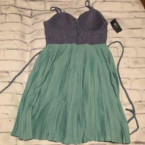 "Jessica Simpson ""Jean"" and pleated skirt dress."